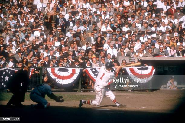 Del Crandal of the Milwaukee Braves swings at the pitch as catcher Yogi Berra of the New York Yankees makes the catch during Game 5 of the 1957 World...