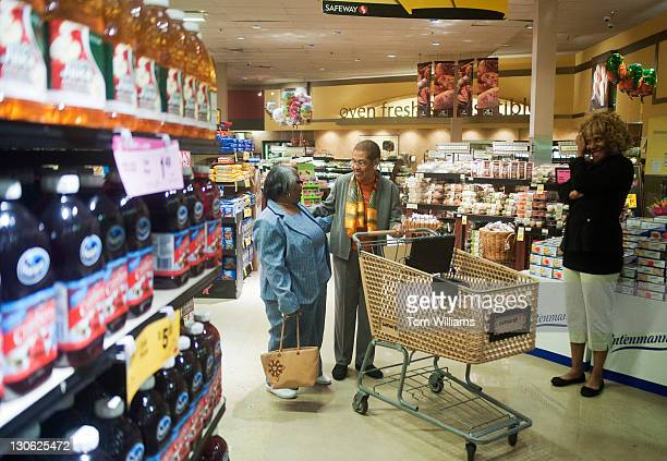 Del Eleanor Holmes Norton DDC center greets DC residents Vernell Livingston left and Vanessa Sherrie at the Safeway on 14th St SE before they shopped...