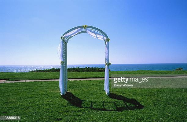 ca, del mar, wedding arch and pacific ocean - wedding background stock pictures, royalty-free photos & images