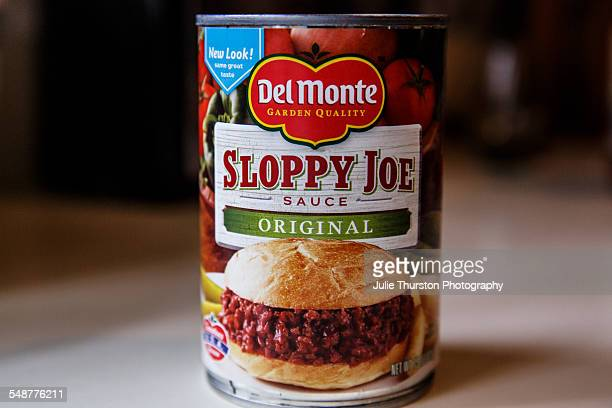 Del Monte brand garden quality original canned Sloppy Joe sauce Label shows a meat sandwich and fresh tomatoes and is on a can sitting in the kitchen...