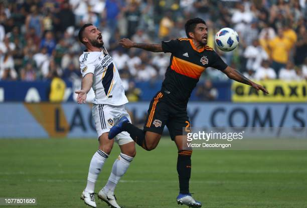 A J DeLaGarza of Houston Dynamo plays the ball off his chest from Romain Alessandrini of Los Angeles Galaxy during the first half of their MLS match...