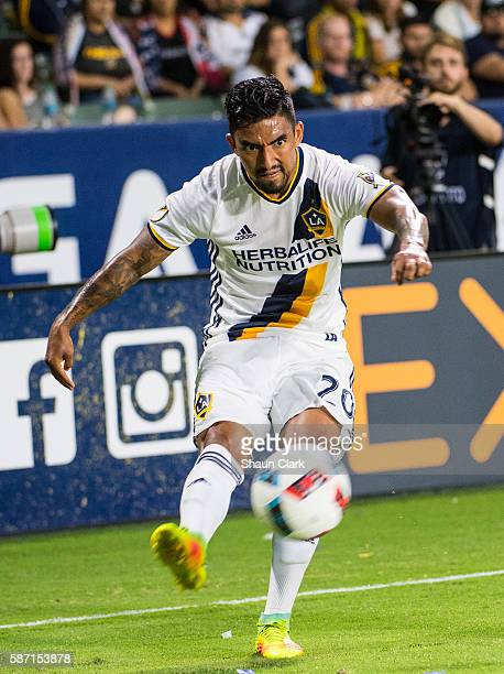 A J DeLaGarza of Los Angeles Galaxy crosses the ball during Los Angeles Galaxy's MLS match against the New York Red Bulls at the StubHub Center on...