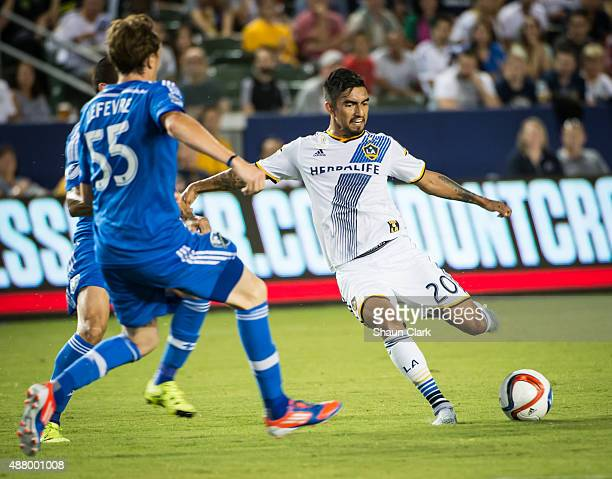 J DeLaGarza of Los Angeles Galaxy takes a shot on goal during Los Angeles Galaxy's MLS match against Montreal Impact at the StubHub Center on...