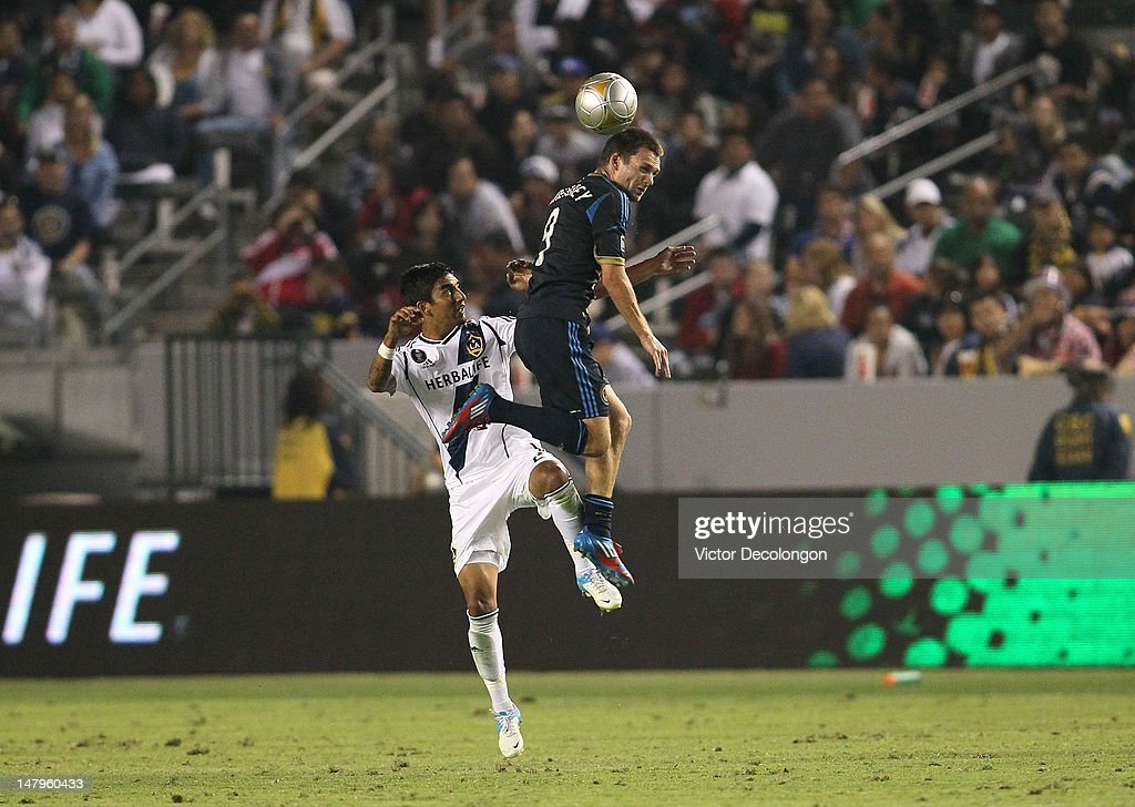 A.J. DeLaGarza #20 of the Los Angeles Galaxy and Jack McInerney #9 of the Philadelphia Uion vie for the ball during the MLS match at The Home Depot Center on July 4, 2012 in Carson, California. The Union defeated the Galaxy 2-1.