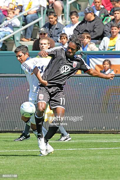 J DeLaGarza of the Los Angeles Galaxy battles for control of the ball against Luciano Emilio of DC United during their MLS game at Home Depot Center...