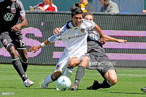 J DeLaGarza of the Los Angeles Galaxy battles for control of the ball against DC United during their MLS game at Home Depot Center on March 22 2009...