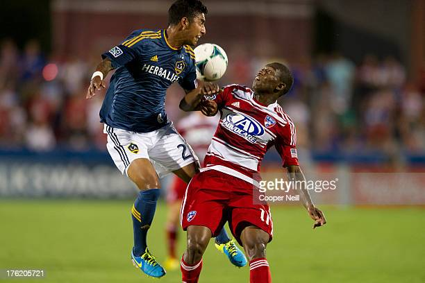 J DeLaGarza of the Los Angeles Galaxy fights for the ball with Fabian Castillo of FC Dallas on August 11 2013 at FC Dallas Stadium in Frisco Texas