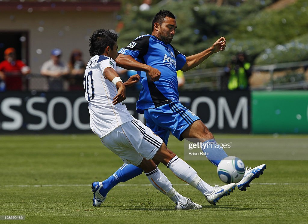 A.J. DeLaGarza #20 of the Los Angeles Galaxy works to get around Arturo Alvarez #10 of the San Jose Earthquakes on August 21, 2010 at Buck Shaw Stadium in Santa Clara, California. The Earthquakes won 1-0.