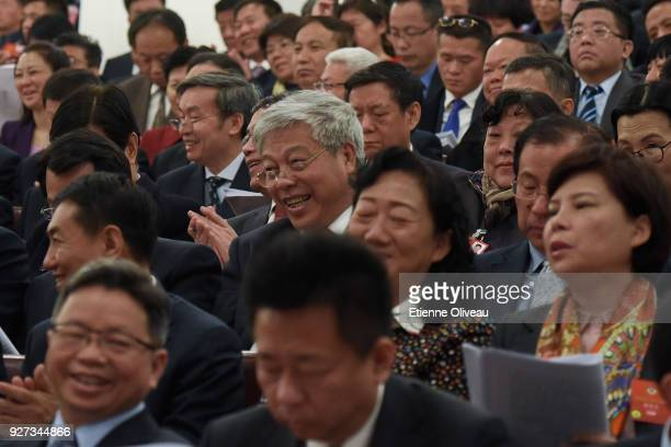 Delagate laughs during the opening session of the 13th National People's Congress at The Great Hall of People on March 5, 2018 in Beijing, China.