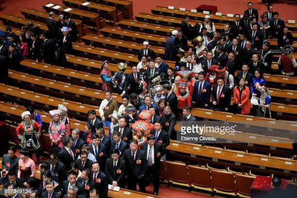 Delagates line up to exit The Great Hall of People after the opening session of the 13th National People's Congress on March 5, 2018 in Beijing,...