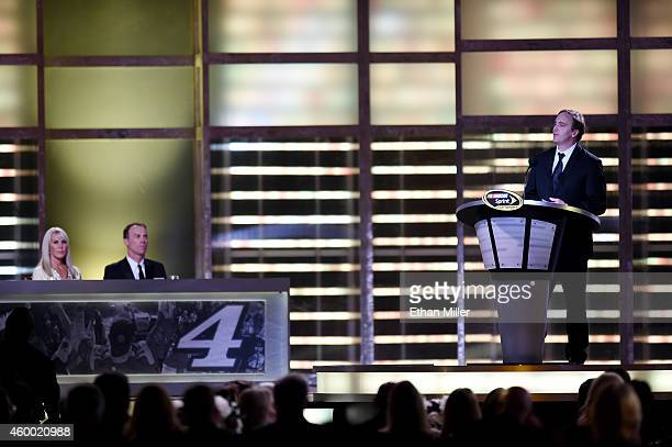 DeLana Harvick and her husband, NASCAR Sprint Cup Series Champion Kevin Harvick, look on as actor/comedian Jay Mohr hosts the 2014 NASCAR Sprint Cup...