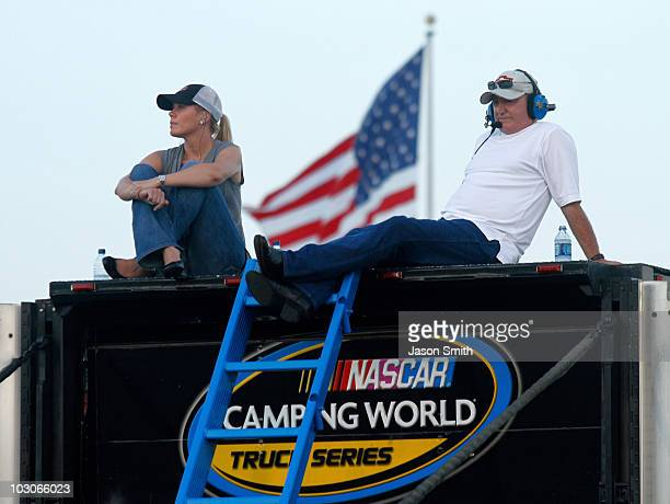 Delana Harvick and team owner Richard Childress watch the NASCAR Camping World Truck Series AAA Insurance 200 at O'Reilly Raceway Park on July 23...