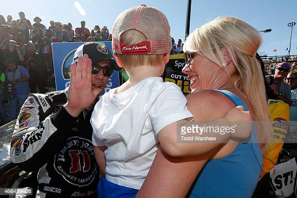 DeLana Harvick, Keelan Harvick and Kevin Harvick, driver of the Budweiser/Jimmy John's Chevrolet celebrate in Victory Lane after winning the NASCAR...