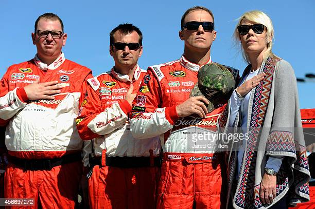 Delana Harvick, Kevin Harvick, driver of the Budweiser Chevrolet, and crew chief Rodney Childers stands on the grid before the NASCAR Sprint Cup...