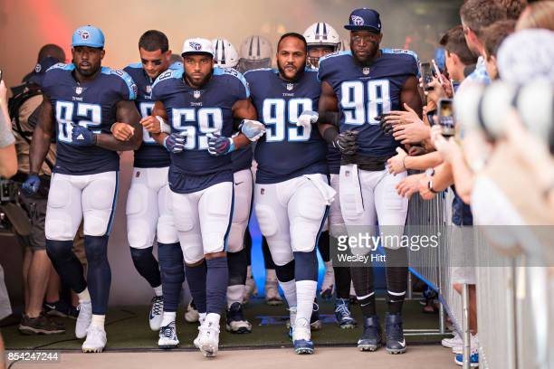 Delanie Walker Marcus Mariota Wesley Woodyard Jurrell Casey and Brian Orakpo of the Tennessee Titans walk out of the tunnel with arms locked before a...