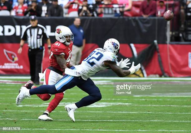 Delanie Walker of the Tennessee Titans attempts to make a diving catch while being defended by Antoine Bethea of the Arizona Cardinals at University...