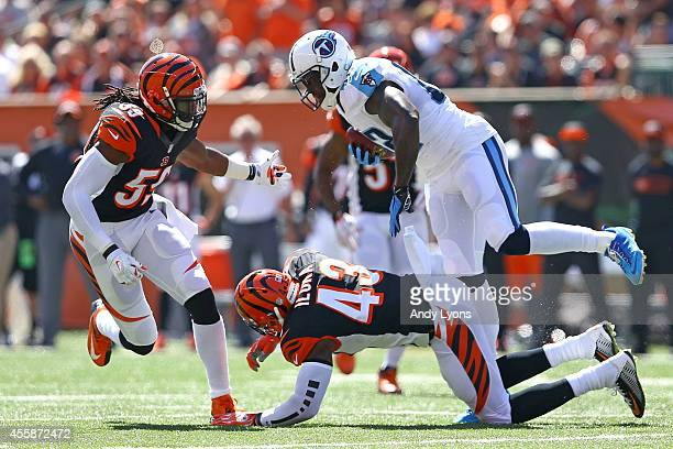 Delanie Walker of the Tennessee Titans avoids the tackle by George Iloka of the Cincinnati Bengals and Emmanuel Lamur of the Cincinnati Bengals...