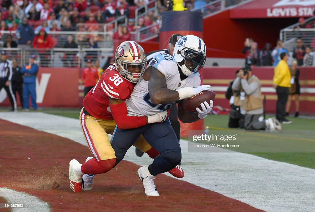 Delanie Walker #82 of the Tennessee Titans catches a touchdown pass over Adrian Colbert #38 of the San Francisco 49ers during their NFL football game at Levi's Stadium on December 17, 2017 in Santa Clara, California.
