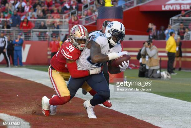 Delanie Walker of the Tennessee Titans catches a touchdown pass over Adrian Colbert of the San Francisco 49ers during their NFL football game at...