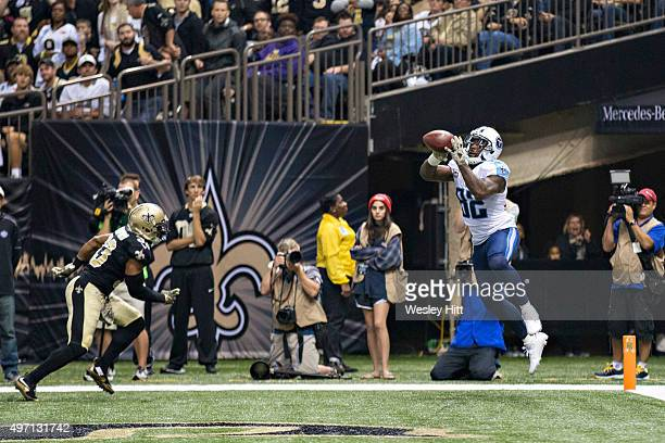 Delanie Walker of the Tennessee Titans catches a touchdown pass against the New Orleans Saints at MercedesBenz Superdome on November 8 2015 in New...