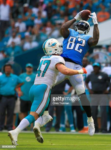 Delanie Walker of the Tennessee Titans fails to complete a reception against the defense of Kiko Alonso of the Miami Dolphins in the first half on...