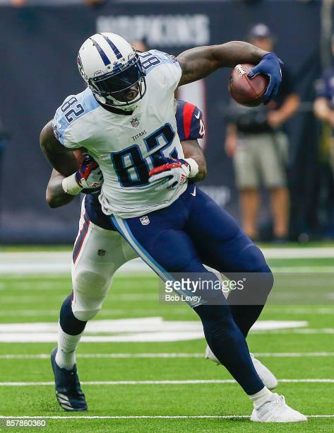 Delanie Walker of the Tennessee Titans is run down from behind by Zach Cunningham of the Houston Texans at NRG Stadium on October 1, 2017 in Houston,...