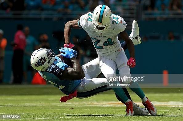 Delanie Walker of the Tennessee Titans makes a catch over Isa AbdulQuddus of the Miami Dolphins during a game on October 9 2016 in Miami Gardens...