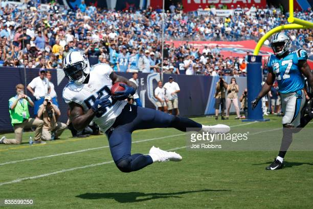 Delanie Walker of the Tennessee Titans makes a fouryard touchdown reception in the first quarter of a preseason game against the Carolina Panthers at...
