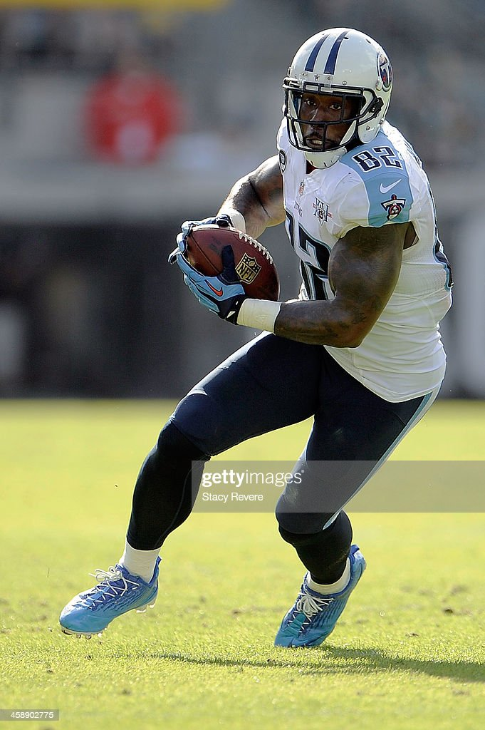 Delanie Walker #82 of the Tennessee Titans runs for yards against the Jacksonville Jaguars during a game at EverBank Field on December 22, 2013 in Jacksonville, Florida. Tennessee won the game 20-16.