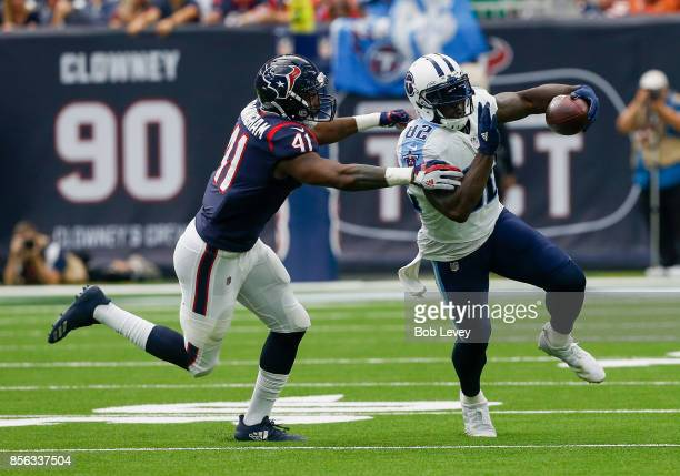 Delanie Walker of the Tennessee Titans runs with the ball after a reception as Zach Cunningham of the Houston Texans attempts to tackle in the second...