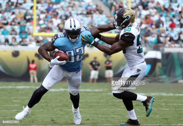Delanie Walker of the Tennessee Titans runs with the football against Telvin Smith of the Jacksonville Jaguars during the second half of their game...