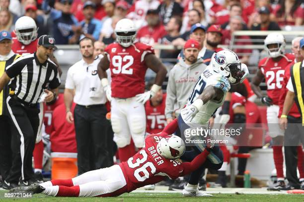 Delanie Walker of the Tennessee Titans runs with the football against Budda Baker of the Arizona Cardinals in the first half of the NFL game at...
