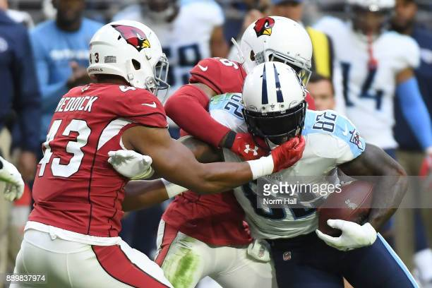 Delanie Walker of the Tennessee Titans runs with the football against Haason Reddick and Brandon Williams of the Arizona Cardinals in the second half...