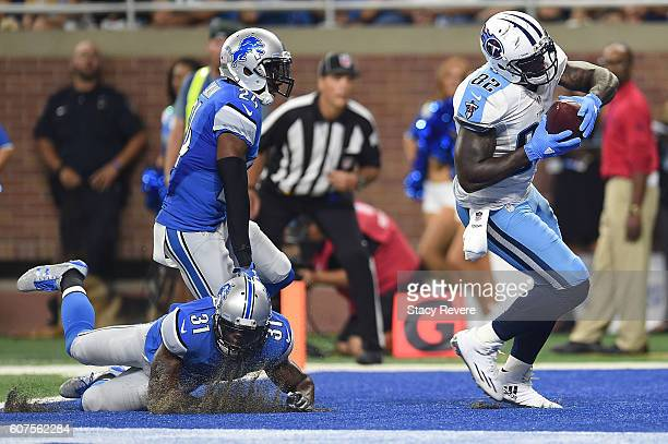 Delanie Walker of the Tennessee Titans scores a touchdown in front of Rafael Bush of the Detroit Lions during the second half of a game at Ford Field...