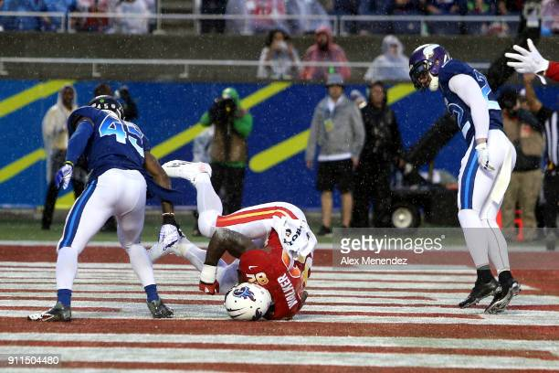 Delanie Walker of the Tennessee Titans scores a touchdown in front of Deion Jones of the Atlanta Falcons during the NFL Pro Bowl between the AFC and...