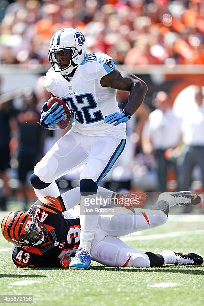 Delanie Walker of the Tennessee Titans steps over George Iloka of the Cincinnati Bengals during the first quarter at Paul Brown Stadium on September...