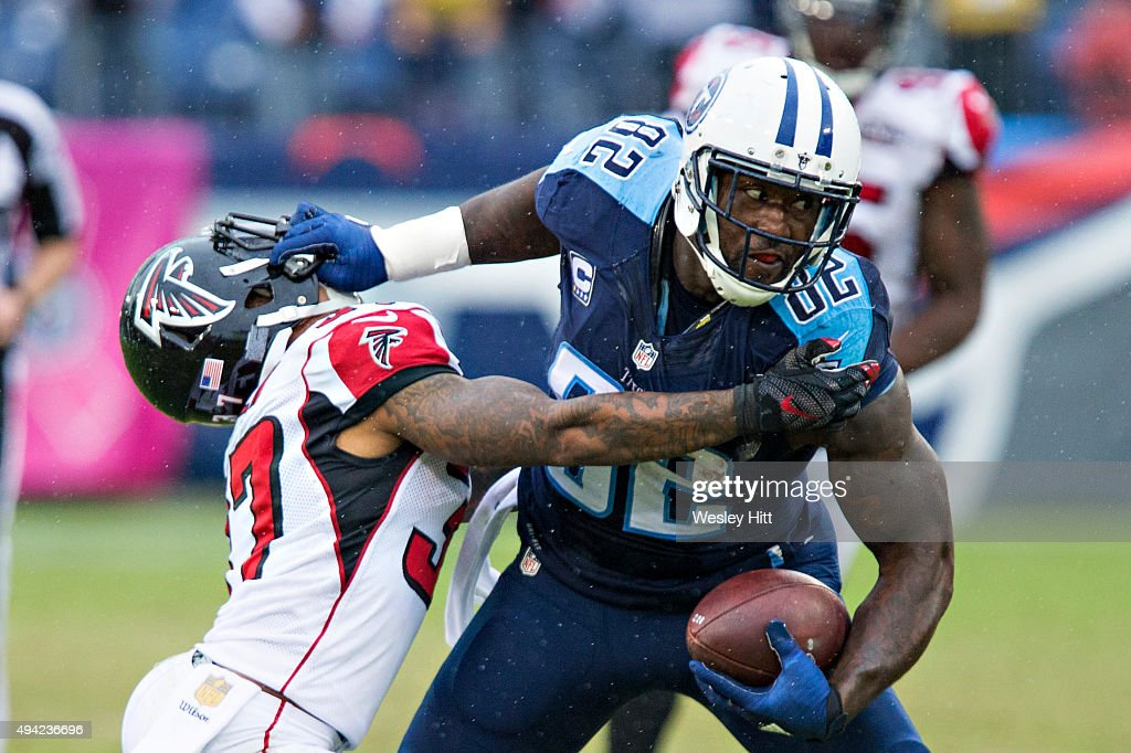Delanie Walker #82 of the Tennessee Titans stiff arms Ricardo Allen #37 of the Atlanta Falcons at Nissan Stadium on October 25, 2015 in Nashville, Tennessee. The Falcons defeated the Titans 10-7.