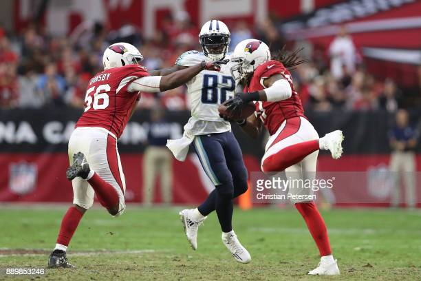 Delanie Walker of the Tennessee Titans watches as Josh Bynes of the Arizona Cardinals makes an interception in the second half at University of...
