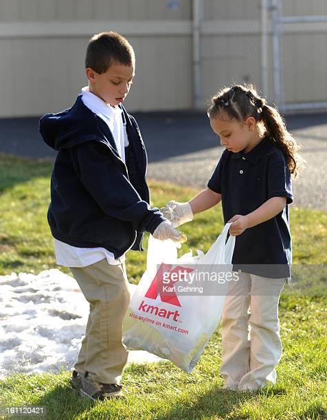 Delano Arias age 9 left and his sister Kalani age 5 picked up garbage outside school during a trash treasure hunt Friday afternoon About twenty kids...