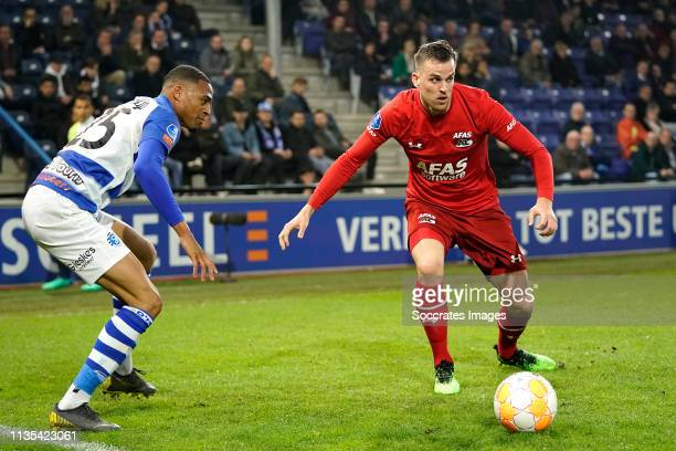Delano Burgzorg of De Graafschap Mats Seuntjens of AZ Alkmaar during the Dutch Eredivisie match between De Graafschap v AZ Alkmaar at the De...