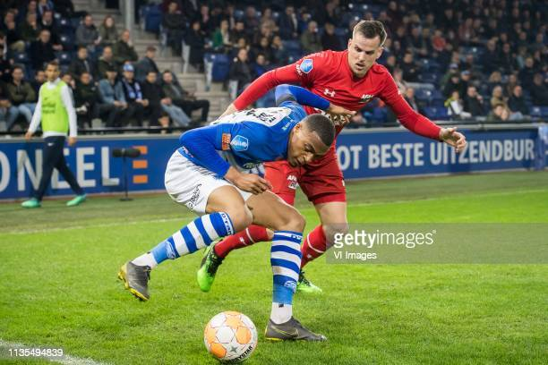 Delano Burgzorg of De Graafschap Mats Seuntjens of AZ during the Dutch Eredivisie match between De Graafschap Doetinchem and AZ Alkmaar at De...