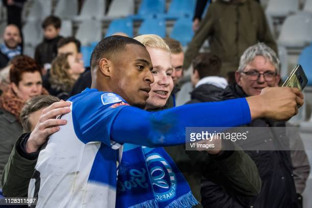 Delano Burgzorg of De Graafschap with a fan during the Dutch Eredivisie match between De Graafschap Doetinchem and ADO Den Haag at De Vijverberg...