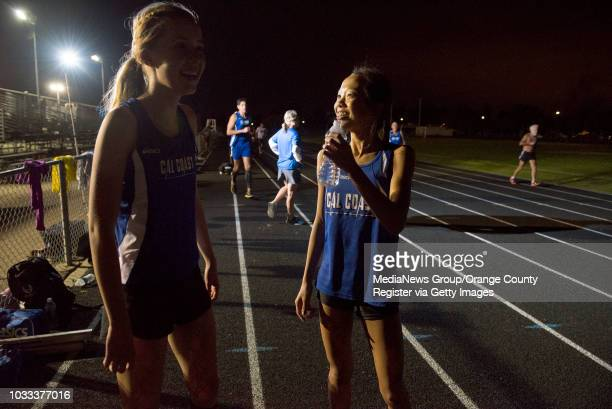Delany Ivey left and Gigi Lee both of Newport Beach take a breather after training with the CalCoast Track Club at the Corona del Mar High School...