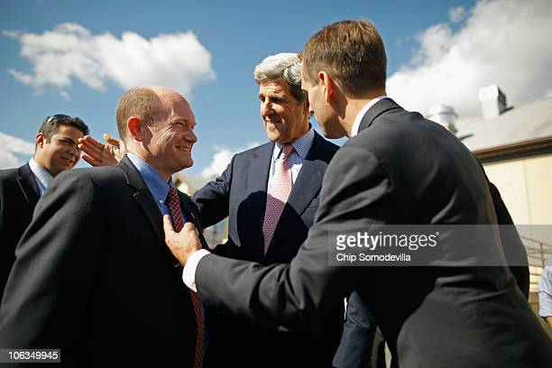 Delaware Democratic Senate nominee Chris Coons thanks US Sen John Kerry and Delaware Attorney General Beau Biden for campaigning with him outside the...