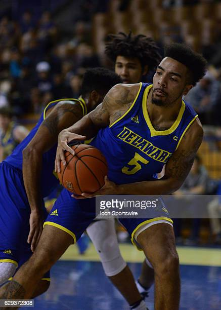 Delaware Fightin Blue Hens Forward Eric Carter grabs the rebound as the Delaware Fightin Blue Hens take on the Yale Bulldogs on December 11 2016 at...