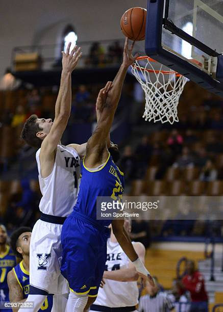 Delaware Fightin Blue Hens Guard Cazmon Hayes blocks the shot attempt of Yale Bulldogs Guard Anthony Dallier as the Delaware Fightin Blue Hens take...