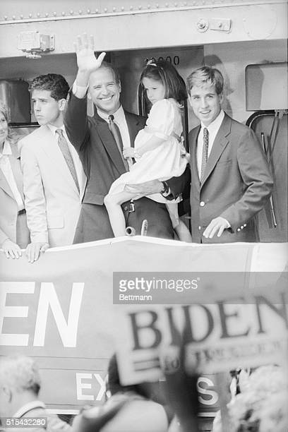 Delaware Senator Joseph Biden smiles and waves from the back of a train to Washington as he holds his little 5yearold daughter Ashley and bids...