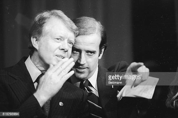 Delaware's US Senator Joseph Biden points out a friend in the crowd at the Padua Academy to President Jimmy Carter during a fundraiser Carter spent...