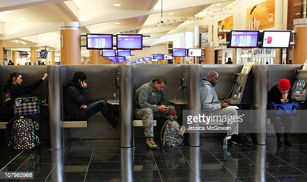 Delayed and stranded passengers waiting for flight information fill cubicles throughout Atlanta HartsfieldJackson International Airport after a snow...