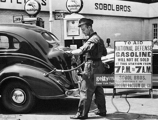 Delbert Guess eyes his watch for gas curfew during WWII gasoline rationing